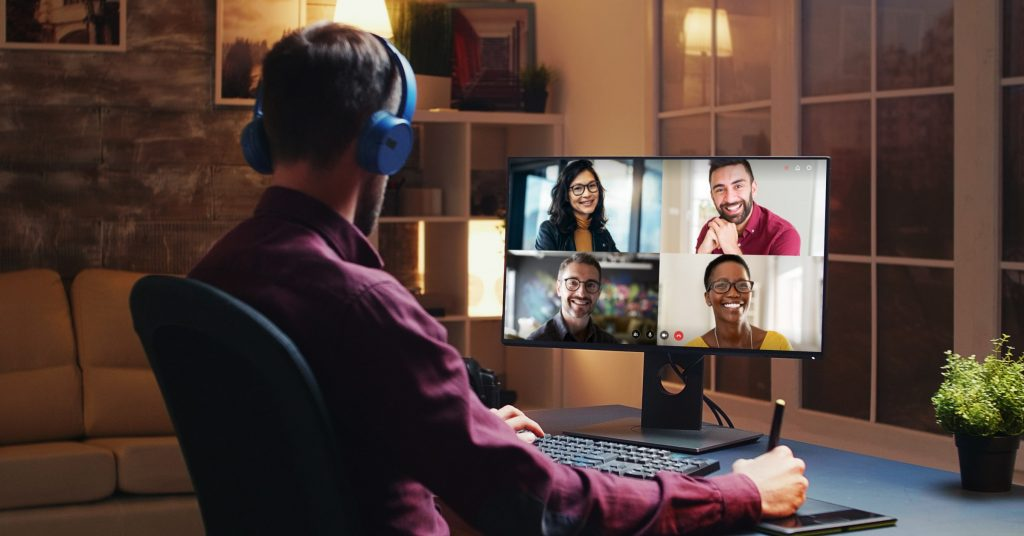 Man videoconferencing with four colleagues from home