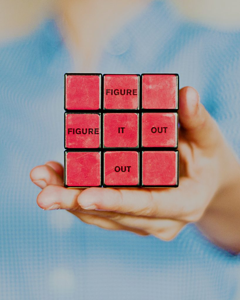A Rubiks cube featuring the words 'figure it out'